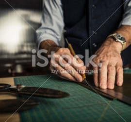 stock-photo-33845414-artisan-working-with-leather